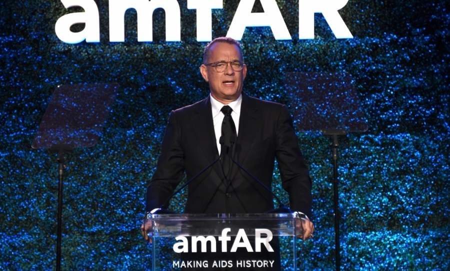 "<p>Tom Hanks, who has twice starred alongside Julia, presented his pal with the with amfAR's ""Award of Courage"" in recognition of her support of the fight against AIDS. <br /><br />Photo: Getty Images</p>"