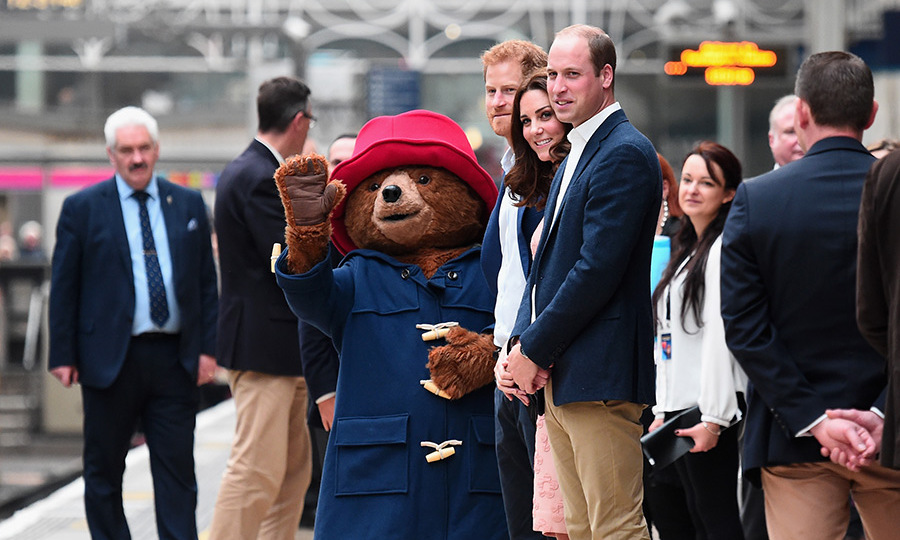 If you were wondering if the royal squad were taking in new members, wonder no more. Paddington Bear became an honorary member of the group during the trio's visit to Paddington Station on Oct 16. 