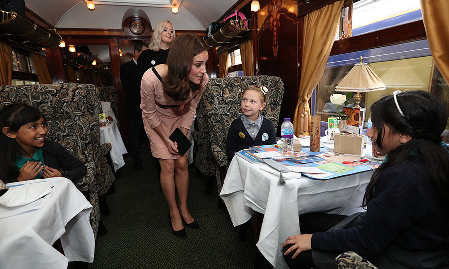 Kate boarded the train to catch up with some lucky passengers who quizzed her on what she loved most about being a 'princess.'