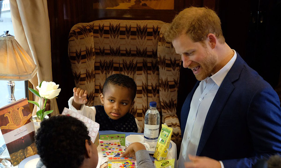 The fun-loving royal had a blast seeing what the kids brought with them to keep them entertained on the train ride. 