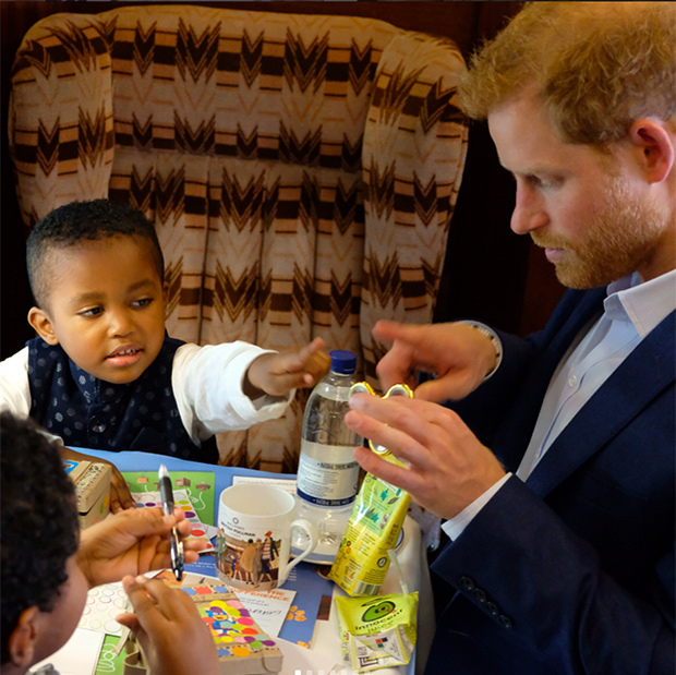 Prince Harry received a quick tutorial from a youngster on how to use a fidget spinner. 