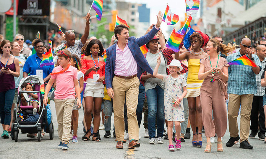 Xavier and Ella-Grace joined their parents to march in Toronto's PRIDE Parade in June 2016. The family cheered happily and waved at the crowd as they made their way down Yonge Street. 