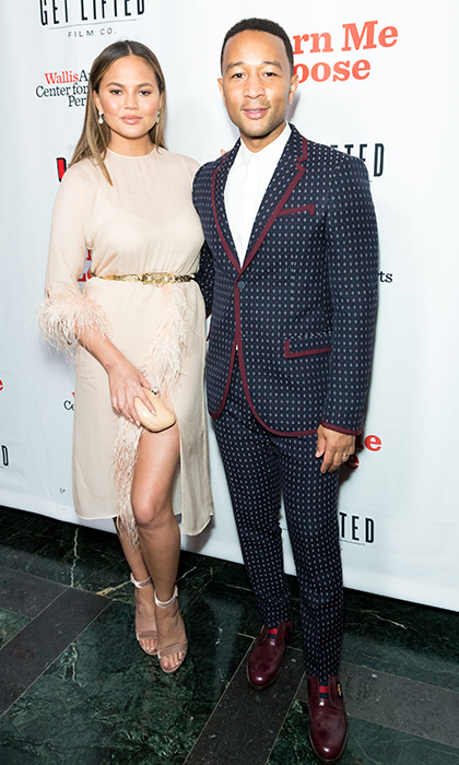Chrissy Teigen and John Legend made one fashionable pair at the opening night of <em>Turn Me Loose</em> in LA on Thursday (Oct. 19).