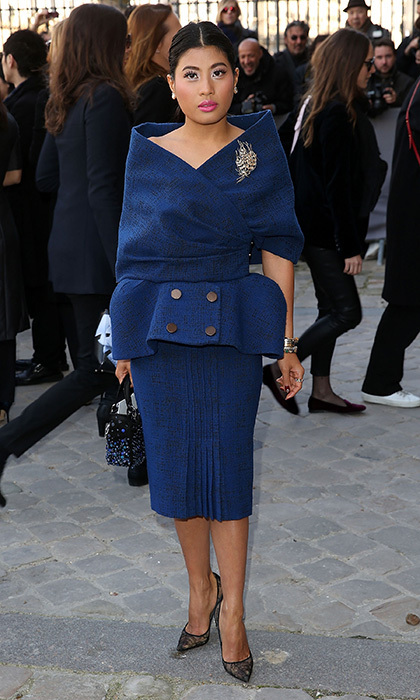 <p>Princess Sirivannavari opted for another vintage silhouette – a modern take on the New Look – at the Fall Winter 2015/2016 Christian Dior show, held at the Louvre museum in March 2015. The dramatic look consisted of a deep blue wrap-style jacket with portrait collar and peplum, along with a pleated skirt. <br /><br />Photo: Danny Martindale/GC Images</p>