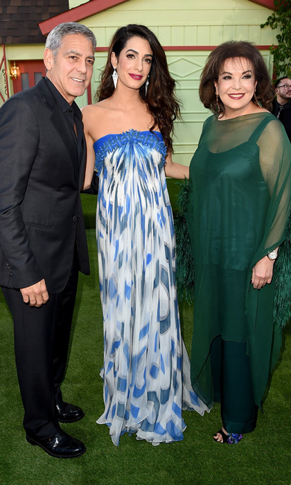 George Clooney was joined at the Los Angeles premiere of his new film <em>Suburbicon</em> by his leading lady, wife Amal. The mom-of-two stunned wearing a strapless blue and white maxi dress. 
