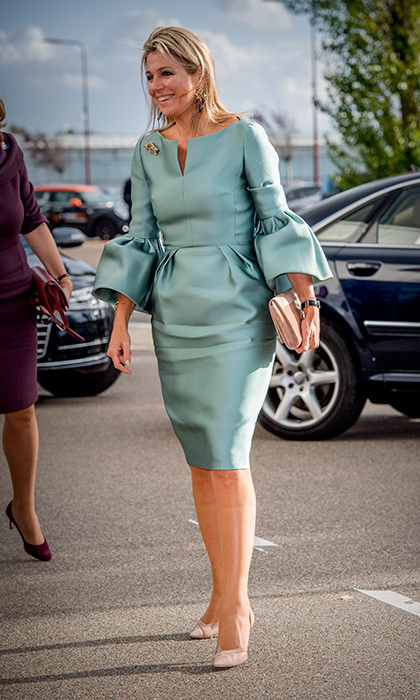 <p>The Dutch Queen wore a bell-sleeved tailored silk dress in a mint hue with powder pink accessories as she arrived at the King Willem I lecture at Koppert Cress in Westland, Netherlands on October 3. Queen Maxima is the honorary chairwoman of the King Willem I Foundation, which highlights and rewards Dutch entrepreneurship. <br /><br />Photo: Patrick van Katwijk/Getty Images</p>