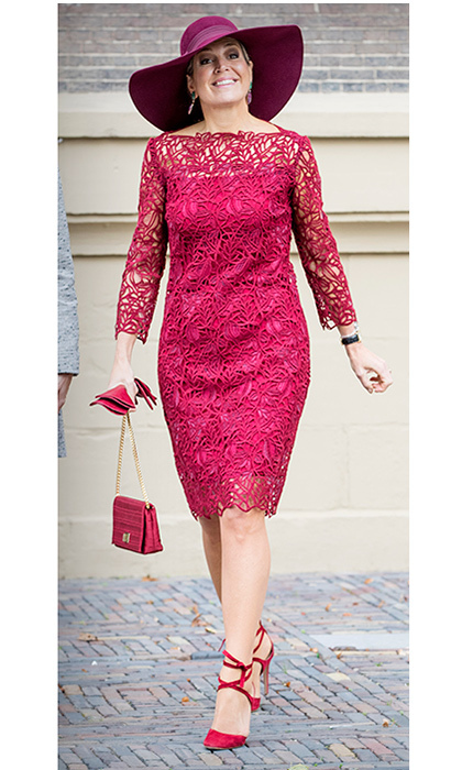 <p>If there's a royal who loves color, it's Argentina-born Queen Maxima of the Netherlands! The monarch's wife chose a hot fuchsia dress with lace overlay to help unveil the traveling exhibition 'Ten Top Pieces On Tour' in the Mauritshuis museum on October 4 in The Hague. Along with her matching purse, gloves and strappy sandals, the Queen topped off her look with one of her signature statement hats in purple.<br/><br/>Photo: Patrick van Katwijk/Getty Images</p>