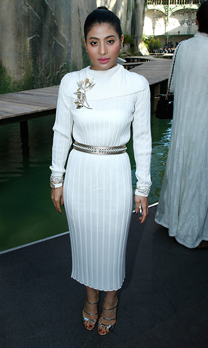 <p>Joining Chanel's star-studded front row was the very fashionable Thai Princess Sirivannavari Nariratana, who wore a midi-length white knit dress with silver accessories. The glamorous royal was one of the most-sought after FROW guests at Paris Fashion Week for the womenswear Spring/Summer 2018 collections. <br /><br />Photo: Bertrand Rindoff Petroff/Getty Images</p>