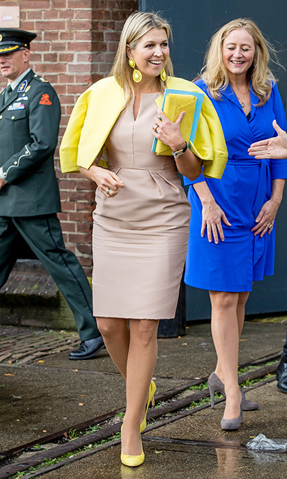 <p>Need a way to add some cheer to your autumn dressing? Add a pop – or four! – of yellow to your outfit. Thanks to those lemony shoes, earrings, jacket and clutch, not even the rain could throw a cloud over Queen Maxima of the Netherlands's sunny look when she attended the Gender & Health of Women Congress In Amersfoort. <br /><br />Photo: Patrick van Katwijk/Getty Images</p>