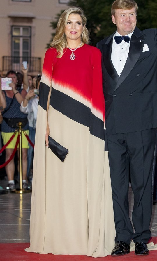 <p>When it comes to color and flair, more is definitely more for Queen Maxima of the Netherlands! King Willem-Alexander's wife wore a bold cape dress with asymmetrical stripe design to a concert at the Dona Maria National Theater Teatro in Lisbon, Portugal on October 11. <br /><br />Photo: Patrick van Katwijk/Getty Images</p>