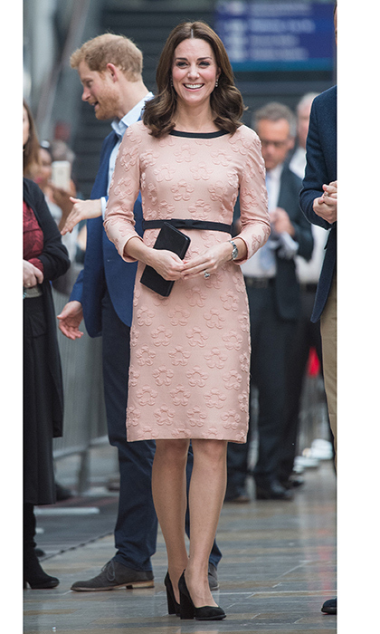 <p>Kate Middleton was pretty in pink in an Orla Kiely dress as she made a surprise appearance at London's Paddington train station with husband Prince William and Prince Harry to meet the cast and crew of the upcoming movie <em>Paddington 2</em>. The Duchess' ladylike look featured a raised floral motif and black details, including a black bow belt which cinched slightly above the pregnant royal's tiny baby bump.<br /><br />Photo: Getty Images</p>