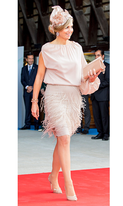 <p>Queen Maxima of the Netherlands wore blush pink on the last day of her tour of Portugal with husband King Willem-Alexander. The fashion-forward royal wore a single-sleeved dress featuring a pretty feather embellished skirt. A matching fascinator, clutch and shoes were the finishing touches on the look.<br /><br />Photo: Getty Images</p>