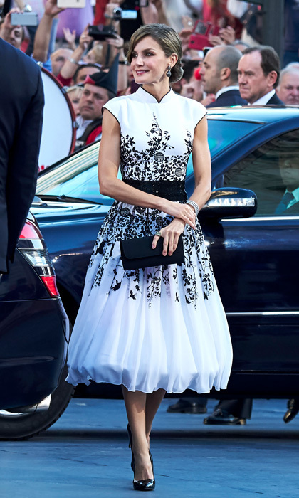 <p>For the Princess of Asturias Awards ceremony on October 20, King Felipe VI's wife wore a white dress that featured black embroidery and a moat neckline with a full skirt. The Spanish royal swept her brunette tresses up in an intricate bun. <br /><br />Photo: Getty Images</p>