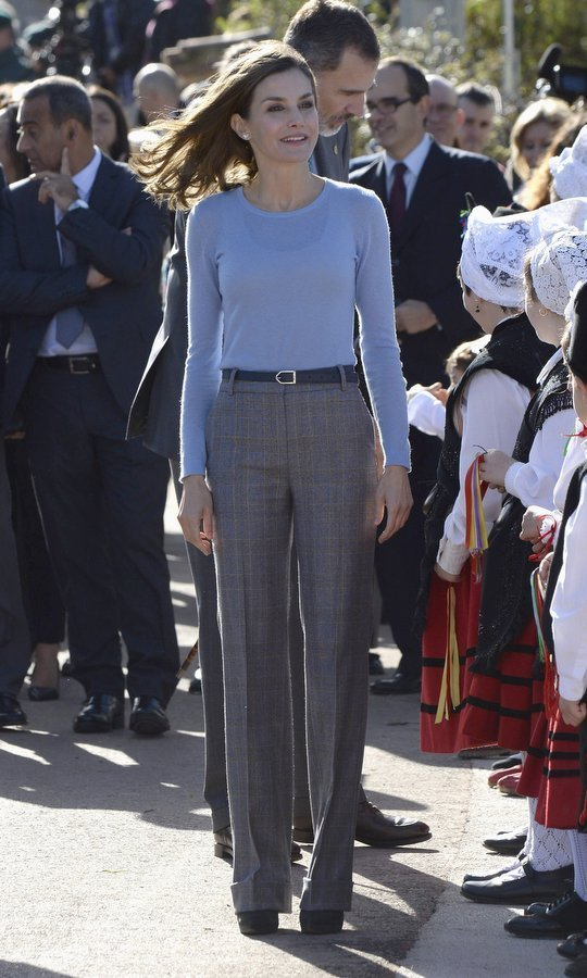 <p>Queen Letizia reached into her closet for some fab fall knits as she visited the village of Poreñu, Spain. We love the simple mix of a blue knit top and menswear-influenced wide leg checked trousers. <br /><br />Photo: Carlos R. Alvarez/WireImage</p>
