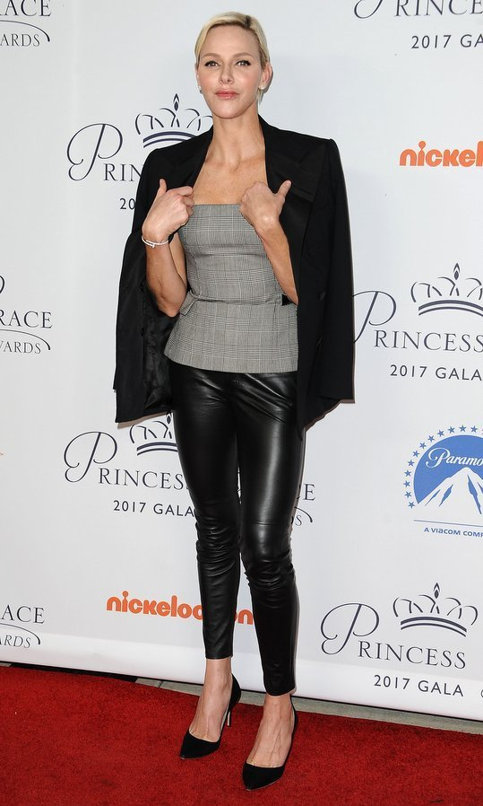 <p>A day earlier, Prince Albert's wife showed off her edgier side in leather leggings, a Ralph Lauren glen check bustier top and tuxedo jacket for the 2017 Princess Grace Awards gala kick off event at Paramount in Los Angeles. She kept her red carpet accessories simple with a bracelet, stud earrings and black high heels.<br /><br />Photo: Jason LaVeris/FilmMagic</p>