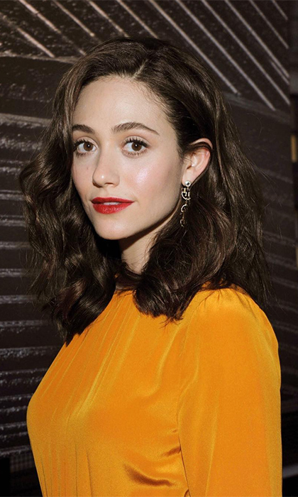 <p>Emmy Rossum looked autumn-chic in a stunning mustard yellow dress while attending Burt's Bees Beauty's I Am Not Synthetic Campaign launch Oct. 25 in New York. The <i>Shameless</i> actress shared that most of her on-screen beauty looks are thanks to the all-natural brand.</p>