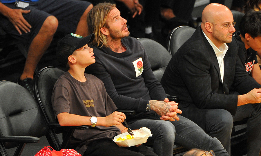 <p>David and Romeo Beckham enjoyed a night out together at the LA Lakers basketball game Oct 25. The father-son duo paid close attention to the game, while Romeo munched on some nachos!</p>