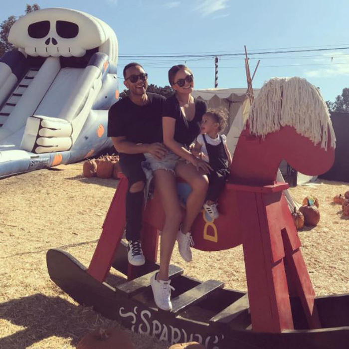 "<p>Chrissy Teigen and John Legend took their daughter Luna to pick out pumpkins. The trio also road an oversized rocking horse. The <em>Cravings 2</em> author captioned this photo, ""hay place. a place for hay.""<br /><br />Photo: Instagram/@chrissyteigen</p>"
