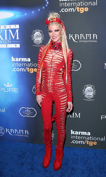 <p><i>American Pie</i> actress Tara Reid wore a daring red ensemble to the Maxim Halloween party.</p>