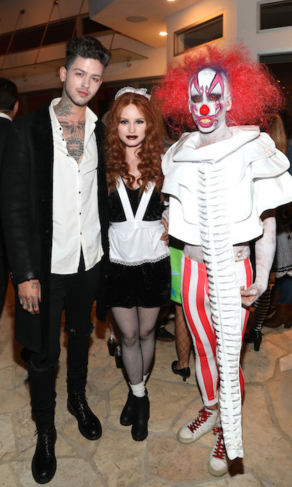 Just Jared's Jared Eng (Right) celebrated his 6th annual Halloween party with <em>Riverdale</em>'s Madelaine Petsch and her boyfriend Travis Mills.