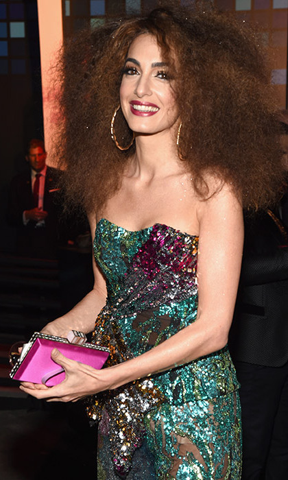Amal Clooney left her husband George at home with the twins to party the night away with Cindy Crawford at the Casamingos bash. 