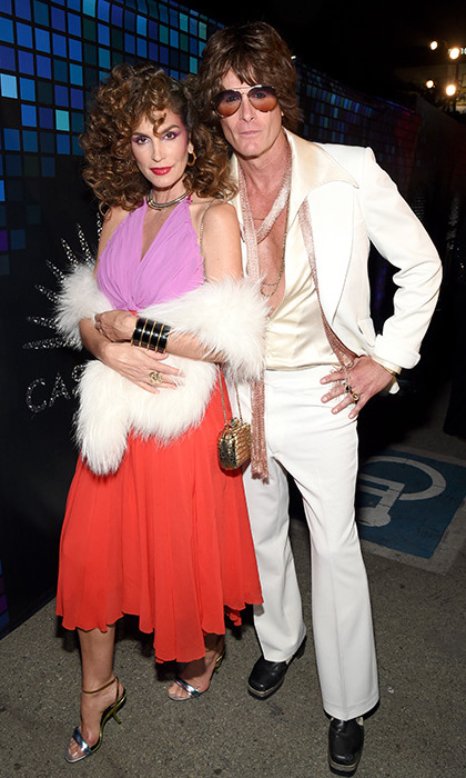 Cindy Crawford and Rande Gerbe were once again the king and queen of couple costumes at their annual Casamigos Tequila party in Hollywood. This year's theme was Disco. 