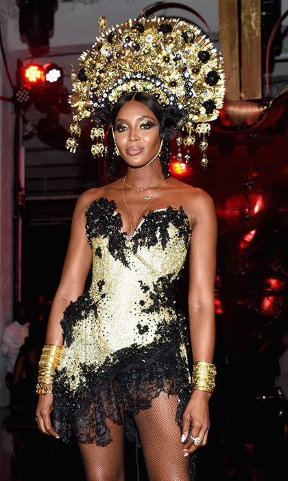 <p>Naomi Campbell wore a stunning golden headpiece and matching mini dress to the amfAR & The Naked Heart Foundation Fabulous Fund Fair.</p>