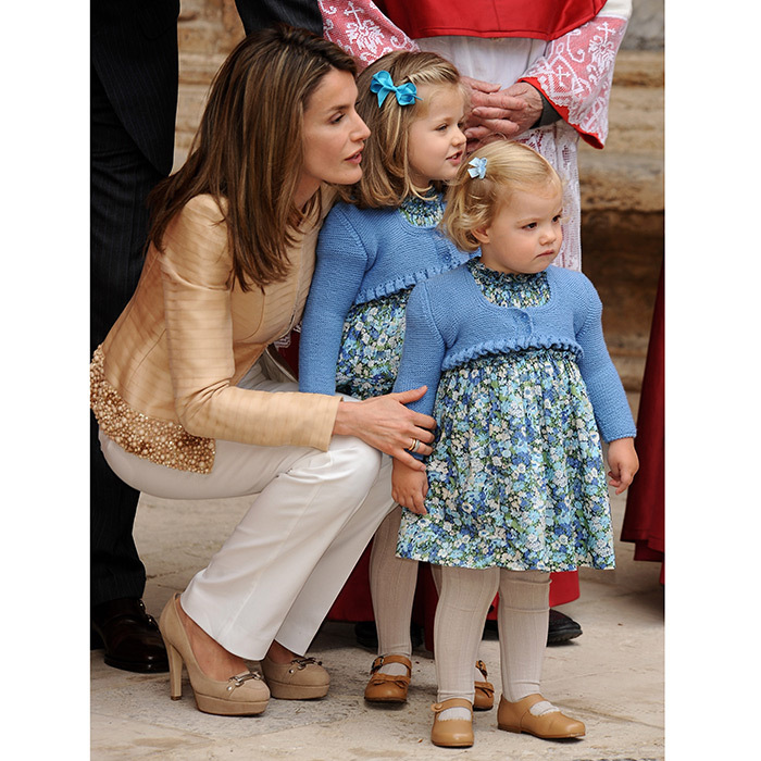 Princess Leonor became a big sister when King Felipe and Queen Letizia's second child, Infanta Sofia, was born in 2007. Even as pre-schoolers the girls were already showing off their now-famous twinning style! They wore matching blue dresses and cardigans as they attended their first-ever joint photocall before Easter Mass on the island of Mallorca, Spain, in April 2009.