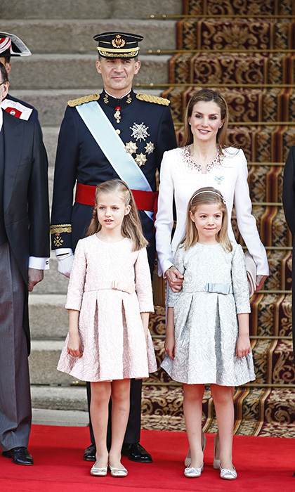 Leonor's title at birth was Her Royal Highness Infanta Leonor of Spain, but when her father Crown Prince Felipe ascended the throne to become King Felipe VI, the young royal inherited the title for the heir to the throne – Her Royal Highness The Princess of Asturias. The young Princess was definitely ready for her closeup at her dad's coronation in Madrid on June 19, 2014. 