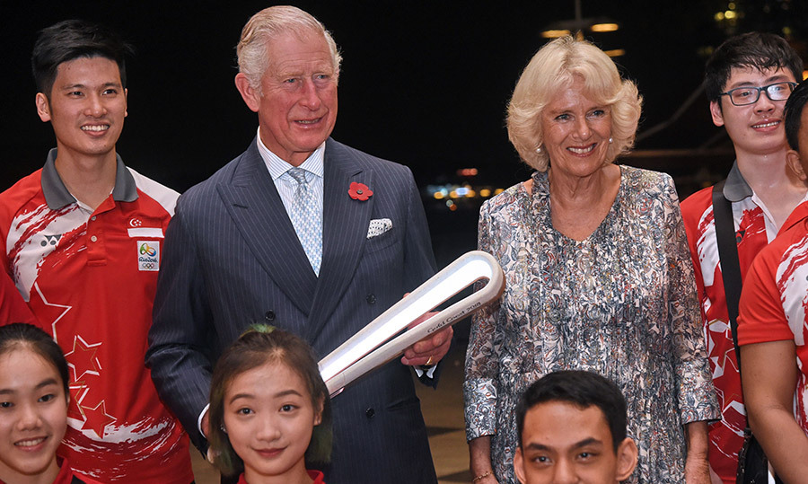 For their first engagement, the royals posed with local athletes during a handover of the Queen's Commonwealth Baton.