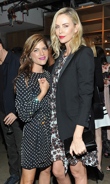 <p>Actors Selma Blair and Charlize Theron looked chic and sophisticated at Porter's Incredible Women Gala in LA Nov 1. The <i>Atomic Blonde</i> star stunned in floral and a boyfriend blazer, while the <i>Anger Management</i> actress looked gorgeous in a polkadot print dress and bright purple lipstick. 
