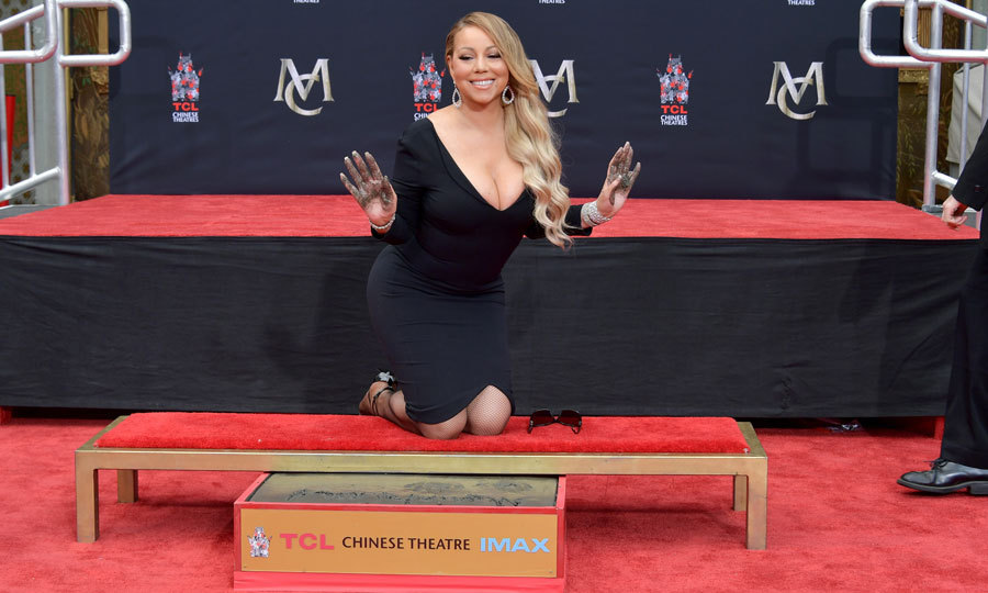 "Mariah Carey wasn't too much of a diva to get her hands dirty while being honoured at her Hand and Footprint Ceremony at the TCL Chinese Theatre in Hollywood. The ""Touch My Body"" singer had boyfriend Bryan Tanaka and BFF Lee Daniels on hand to support her during the event.