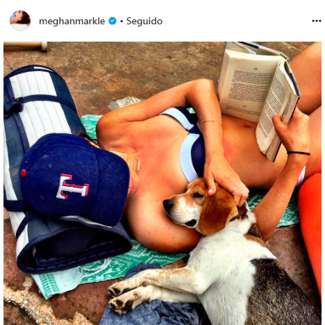 <p>A bikini, book, furry pal... and a baseball hat to protect her skin from the sun. She has plenty of baseball hats in her collection, including this red white and blue Texas Rangers topper. <br /><br />Photo: Instagram/@meghanmarkle</p>