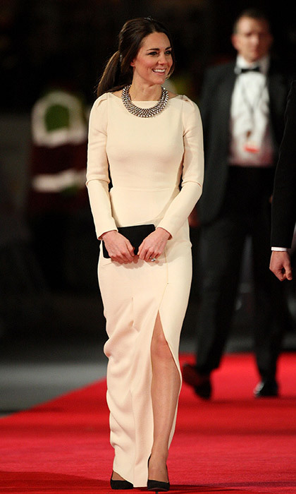 Kate dazzled at the <em>Mandela: Long Walk to Freedom</em> premiere in London, recycling the white Roland Mouret gown with a statement necklace from Zara in December 2013.