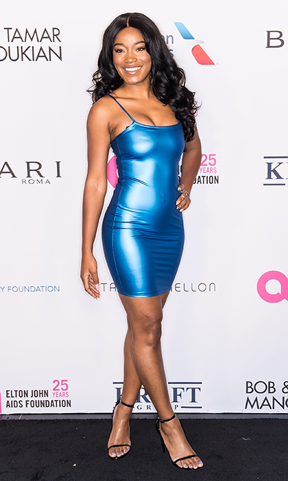 <p>Keke Palmer showed off her dazzling smile as she arrived at the the Elton John AIDS Foundation gala. The singer stunned in a body-hugging metallic blue dress, paired with simple black sandals.