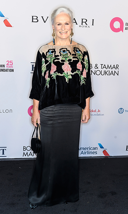 <p>Legendary actress Glenn Close debuted a totally elegant look as she arrived at the Nov 7 Elton John AIDS Foundation's 25th year gala. The star, 70, wore a velvet embroidered blouse and a satin black floor-length skirt, paired with statement earrings and a bright smile.