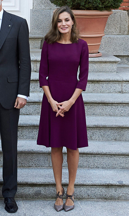 <p>Underneath her stylish trench, Queen Letizia wore a purple day dress by BOSS Hugo Boss with her Magrit shoes. Here she stands on the steps of Zarzuela Palace before the official lunch for the Israeli president and his wife on November 6. <br /><br />Photo: Carlos Alvarez/Getty Images</p>