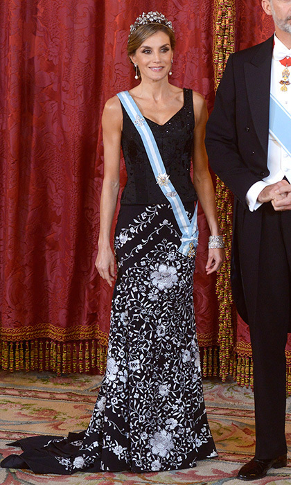 <p>For the official dinner for Israel's President at the Royal Palace in Madrid, the Spanish Queen reached way back into her wardrobe for this Lorenzo Caprile skirt. The traditionally embroidered 'mantón'-style piece has been in Letizia's closet since around 2004. The royal completed her outfit with the floral tiara that was given to her by her mother-in-law Queen Sofia.<br /><br />Photo: Borja Benito - Pool/Getty Images</p>