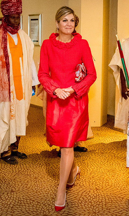 <p>Another bright creation from one of the Dutch Queen's favorites, Natan! Maxima wore this ensemble on day 3 of her Nigeria visit, as she attended the Enhancing Financial Innovation and Access conference, where she was set to speak. <br /><br />Photo: Patrick van Katwijk/Getty Images</p>