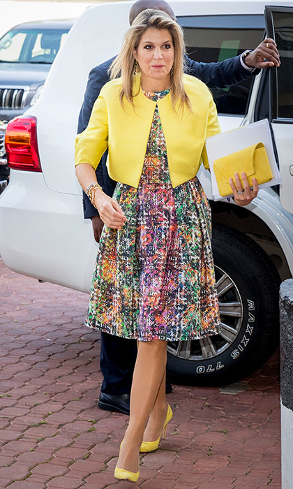 <p>Queen Maxima of the Netherlands famously loves cheery hues, and for her visit to Nigeria she made sure to pack some of her favorites! On November 1, the monarch's wife wore a bright print Natan dress with even brighter accessories – a clutch and yellow pumps that perfectly matched her cropped jacket – for a visit to the local UN office. <br /><br />Photo: Patrick van Katwijk/Getty Images</p>