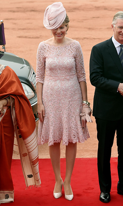 <p>Also traveling abroad is Queen Mathilde of Belgium, who headed to India with husband King Philippe. On November 7, for a ceremonial reception at the Indian Presidential palace in New Delhi, the Belgian Queen wore a dress with powder pink lace overlay, and accessories to match. <br /><br />Photo: MONEY SHARMA/AFP/Getty Images</p>