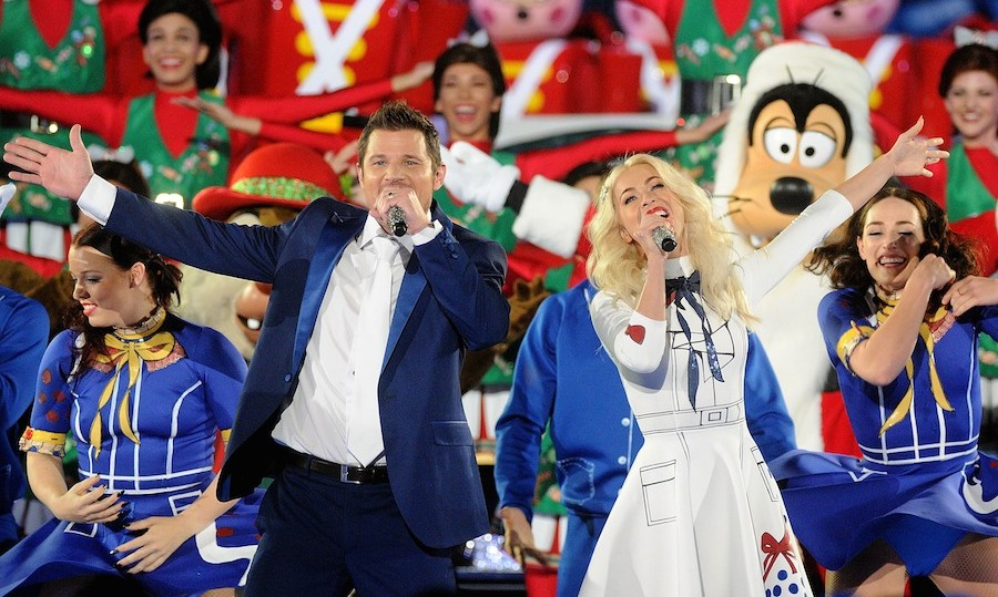 It's beginning to look a lot like Christmas! Nick Lachey and Julianne Hough got into the holiday spirit to tape ABC's <i>The Wonderful World Of Disney: Magical Holiday Celebration</i> at Walt Disney World on Nov. 5. The festive special airs on Nov. 30. 