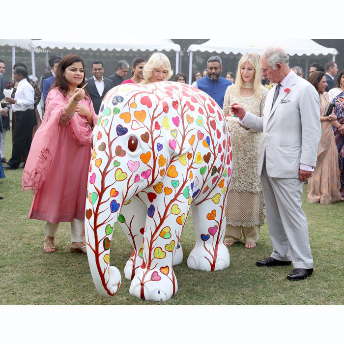 <p>The duo visited an Elephant Parade during the Elephant Family charity event at the British High Commissioner's Residence. They each took a turn painting one of the sculptures named after the 101 elephant corridors that have been mapped across the country.<br /><br />Photo: Getty Images</p>