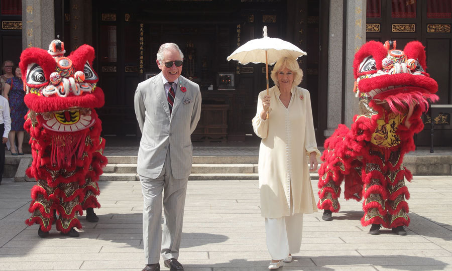<p><strong>November 7</strong><br/><br/>The royal couple stylishly were a part of a lion dance performance during a visit to Han Jiang Temple in Penang, Malaysia.<br/><br/>Photo: Getty Images</p>