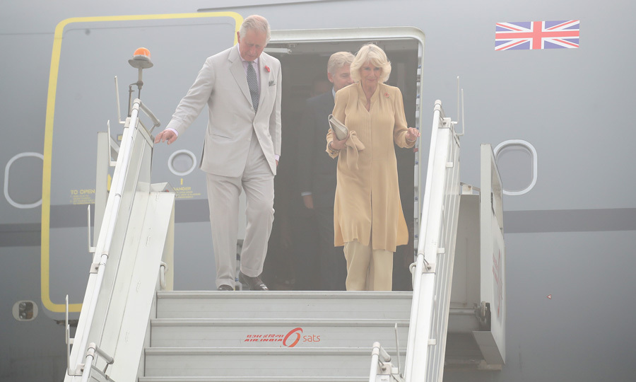 <p><strong>November 8</strong><br /><br />The royal couple didn't let the smog keep their spirits down as they arrived into New Delhi, India. The two descended the stairs of their plane before a two-day visit in the country.<br /><br />Photo: Getty Images</p>