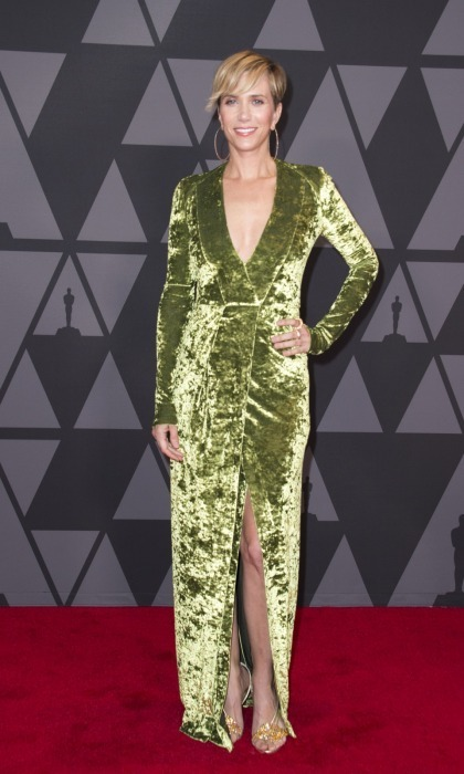 <p>Kristen Wiig kept the velvet trend going, flaunting her figure in a smooth green Galvan number. The funny lady accessorised with Nicholas Kirkwood heels, Djula hoops, and Atelier Swarovski rings.</p>