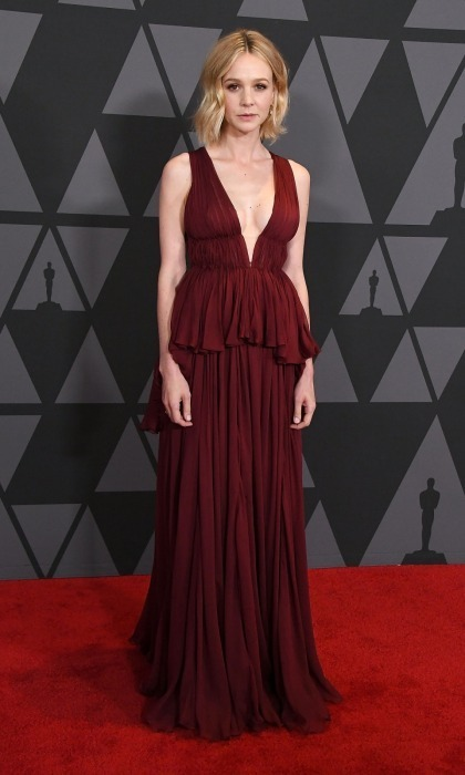<p>Miss Scarlett! Carey Mulligan turned heads in a deep red Giambattista Valli Couture dress. The design featured a plunging neckline and frilled waist flourish. Her short locks perfectly framed her face as she headed down the carpet.</p>