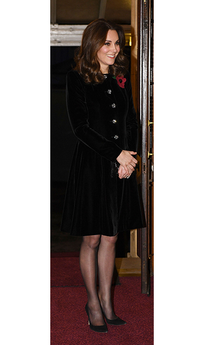 A solo Kate joined the Queen at this year's Royal Service of Remembrance at Royal Albert Hall. She covered her bump in a velvet evening coat by Catherine Walker, and accessorized her ensemble with Princess Diana's Collingwood Pearl and Diamond Earrings.  
