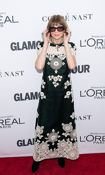 Legendary <i>Vogue</i> editor-in-chief Anna Wintour poses for a glam photoshoot at Glamour's Women of the Year awards Nov 13. Of course, she's donning her classic sunglasses!