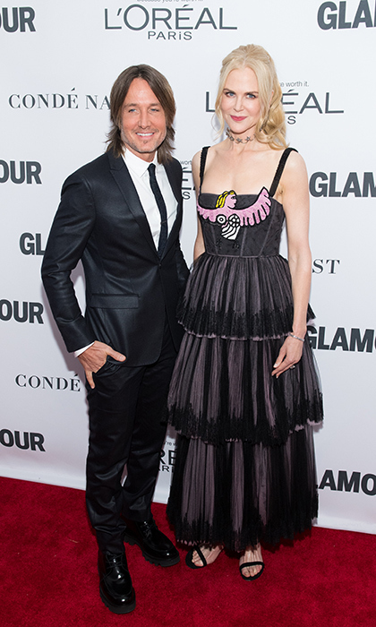 Hollywood's favourite couple Nicole Kidman and Keith Urban arrived at Glamour's Women of the Year summit Nov 13. The two looked happy as ever, Nicole in a unique layered dress and Keith in a tailored suit. This year, she took home the Glamour film actress award.